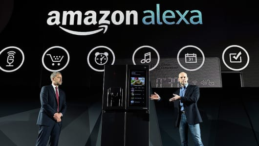 LG Electronics USA Vice President of Marketing David VanderWaal (L) and Amazon Vice President of Alexa, Echo and Appstore Mike George a LG press event for CES 2017 at the Mandalay Bay Convention Center on January 4, 2017 in Las Vegas, Nevada.
