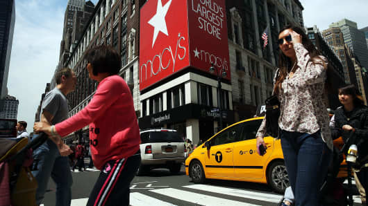 Pedestrians walk by Macy's flagship store in Herald Square in New York.