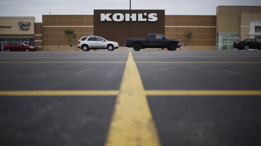 Vehicles sit parked in front of a Kohl's department store in Ashland, Ky.