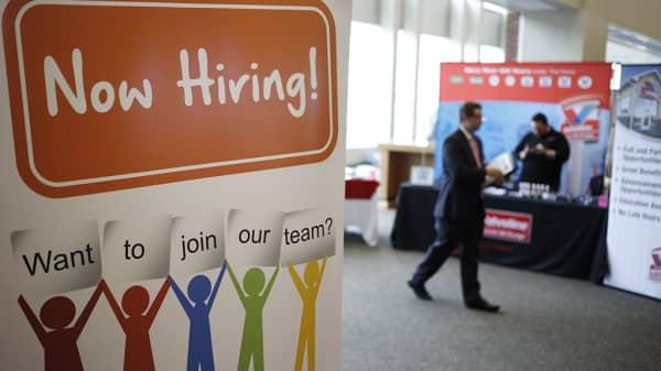 A 'Now Hiring' sign is displayed during a Job News USA career fair at Papa John's Cardinal Stadium in Louisville, Kentucky, U.S., on Wednesday, May 18, 2016.