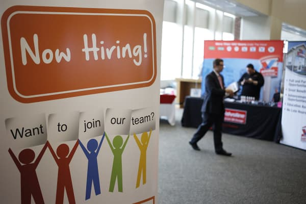A 'Now Hiring' sign is displayed during a Job News USA career fair at Papa John's Cardinal Stadium in Louisville, Kentucky, U.S., on Wednesday, May 18, 2016.