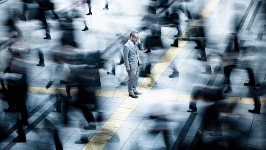 Businessman facing opposite direction