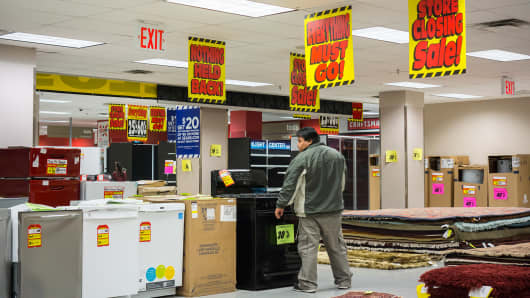 Customers search for appliance bargains at the soon to be closing Sears store in the New York borough of the Bronx.
