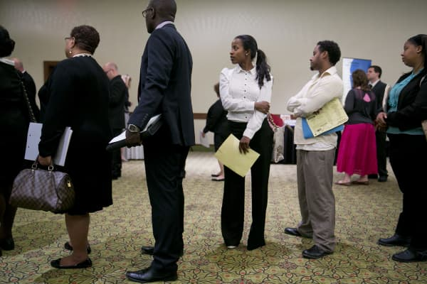 Woman waits to have her resume looked at during the Choice Career Fairs job fair in Arlington, Virginia, U.S., on Thursday, June 6, 2013.