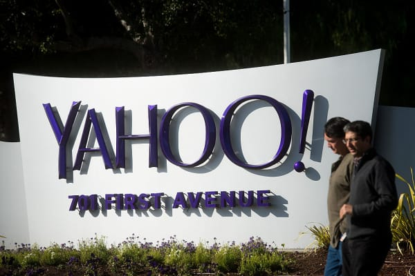 People walk on the Yahoo! Inc. headquarters corporate campus in Sunnyvale, California, U.S., on Thursday, Jan. 7, 2016.