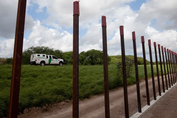 A section of the Border Wall is under construction just south of the UT-Brownsville/Texas Southmost College campus next to the Rio Grande River. The 20-foot high concrete and steel wall is being built in sections throughout south Texas.