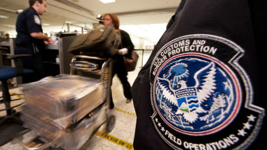 An international air traveler is cleared by a U.S. Customs and Border Protection Officer inside the U.S. Customs and Immigration area at Dulles International Airport.