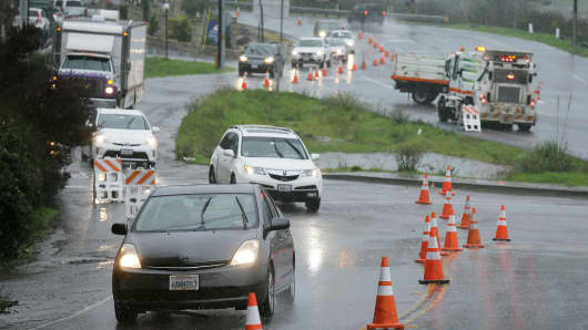 Traffic is diverted around flooded areas in Mill Valley, Calif. last month.