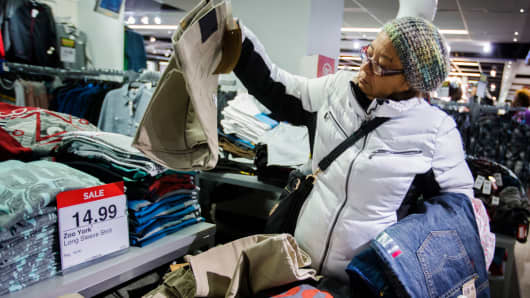 A shopper looks at items on sale inside of a JC Penney store in New York.