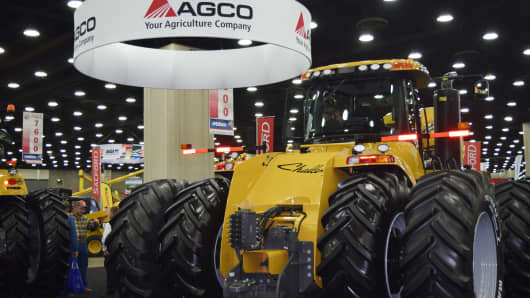 People look at AGCO equipment as they attend National Farm Machinery show in Louisville, Kentucky, February 12, 2016.