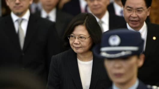 Taiwan President Tsai Ing-wen (C) is escorted by security staff before departing from Taoyuan airport on January 7, 2017.