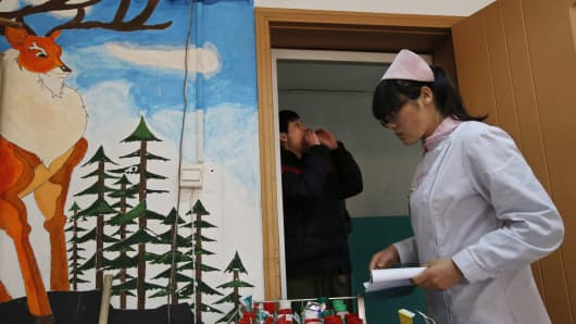 A nurse distributes medicine at Daxing Internet Addiction Treatment Center in Beijing.