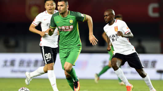 Burak Yilmaz of Beijing Guo in action during a China Super League match between Hebei China Fortune FC and Beijing Guo at Qinhuangdao Olympic Sports Center Stadium on July 16, 2016 in Qinhuangdao, China.