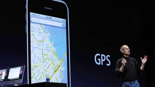 Apple CEO Steve Jobs announces aGPS feature on the new iPhone 3G as he delivers the keynote address at the Apple Worldwide Web Developers Conference June 9, 2008 in San Francisco, California.