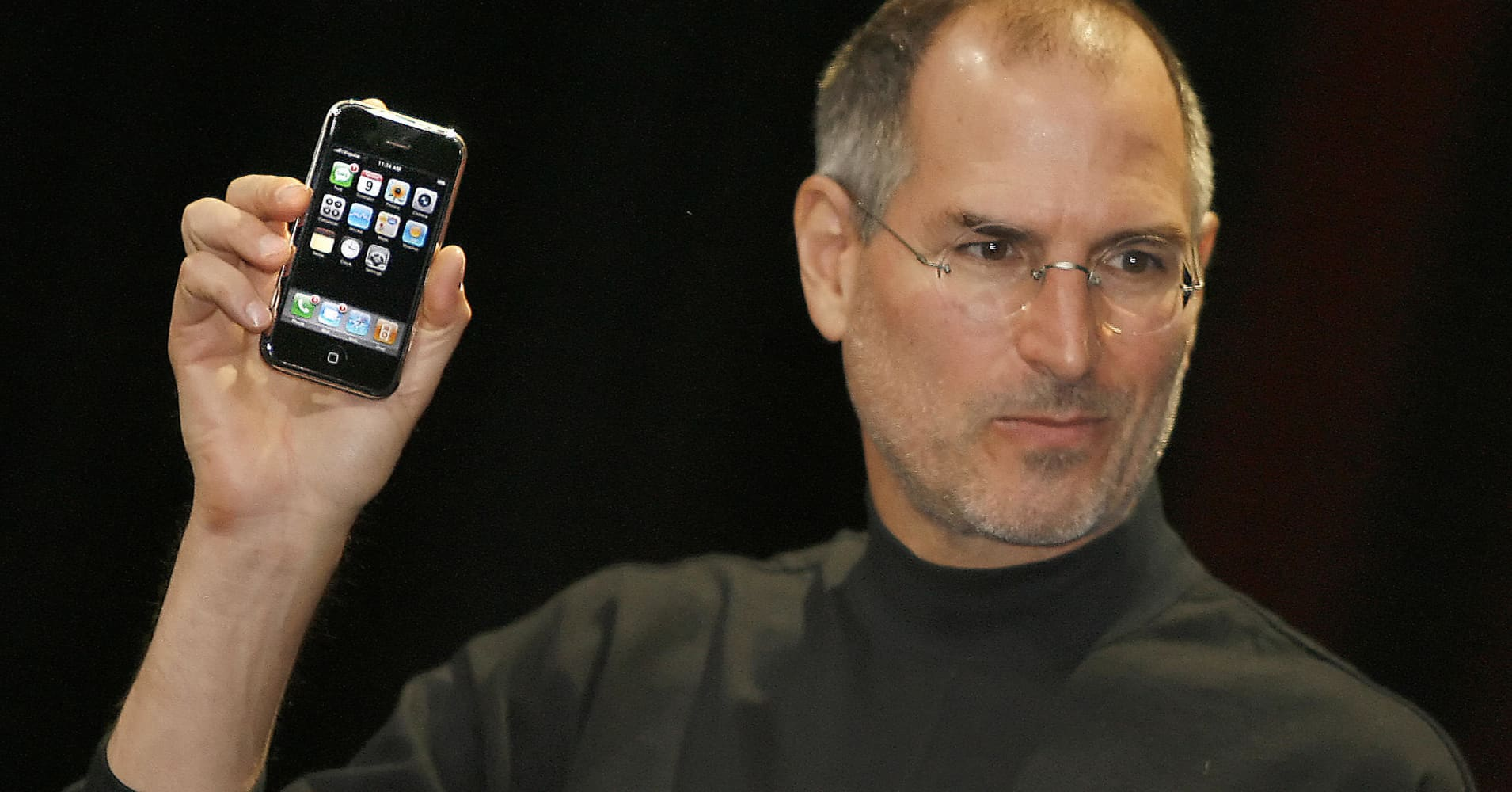 Steve Jobs holds up the original iPhone at the Macworld Conference 09 January 2007 in San Francisco, California.