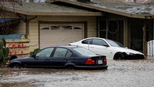 A partially submerged home and vehicles are seen during a winter storm in Petaluma, California, January 8, 2017.