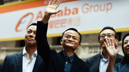 Chinese online retail giant Alibaba CEO Jack Ma (C) waves as he arrives at the New York Stock Exchange in New York on September 19, 2014.