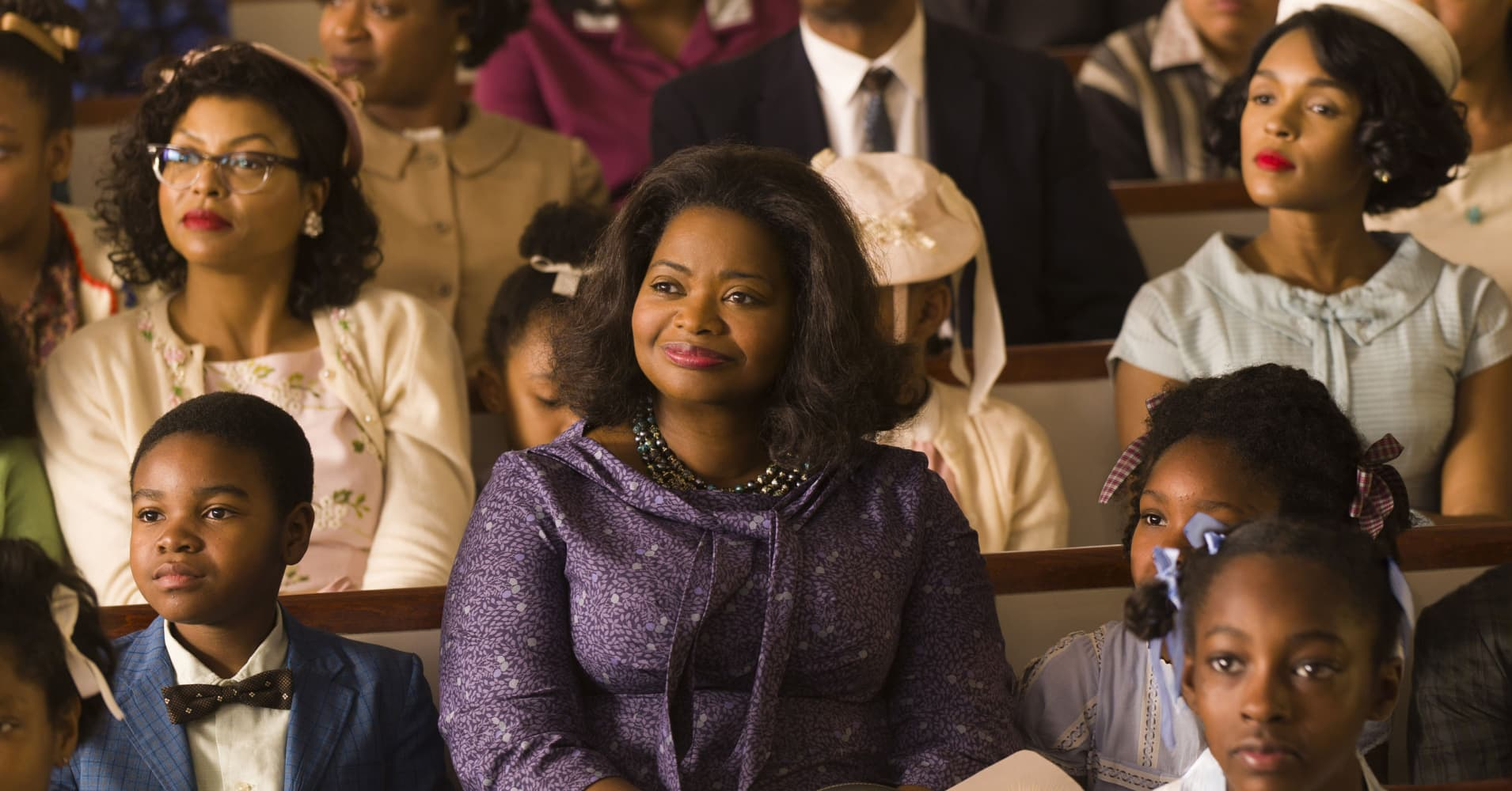 "This image released by Twentieth Century Fox shows Taraji P. Henson, background left, Octavia Spencer, center, and Janelle Monae, background right, in a scene from ""Hidden Figures."""