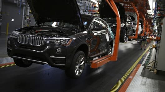 Bayerische Motoren Werke AG (BMW) vehicles move down the assembly line at the BMW Manufacturing Co. assembly plant.