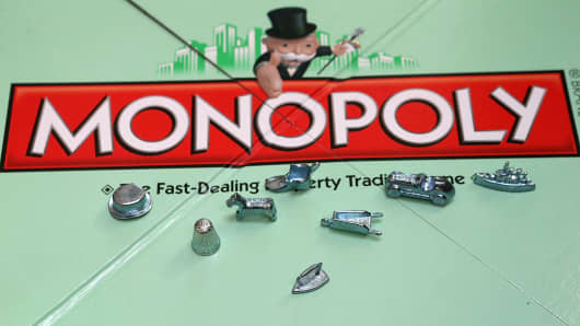 Monopoly tokens on display.