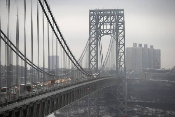 Traffic moves over the Hudson River and across the George Washington Bridge between New York City (R), and in Fort Lee, New Jersey.