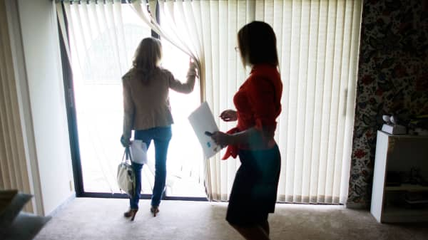 A real estate agent shows a home to a prospective buyer in Miami.