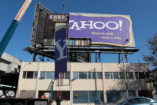 Workers use a crane to move a section of a Yahoo! billboard on December 21, 2011 in San Francisco, California. Yahoo's iconic retro-style billboard was taken down after 12 years of greeting visitors to San Francisco.