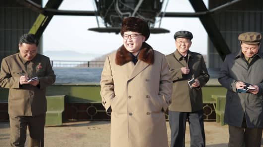 North Korea leader Kim Jong Un smiles as he visits Sohae Space Center in Cholsan County, North Pyongan province for the testing of a new engine for an intercontinental ballistic missile (ICBM) in this undated photo released by North Korea's Korean Central News Agency (KCNA) on April 9, 2016.
