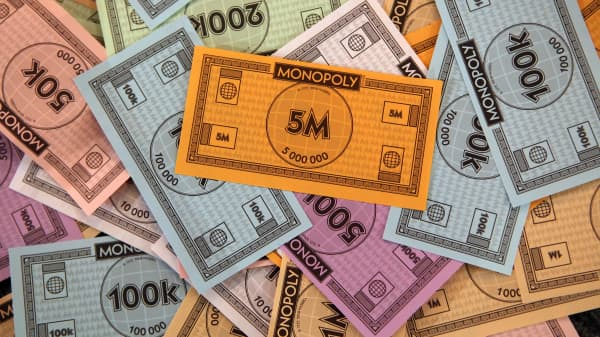 A 5 million denomination note sits on top of a stack of notes for the new Monopoly City version of the classic board game.