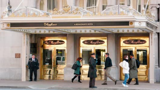People walk past the main entrance of the Mayflower Hotel in Washington March 11, 2008.