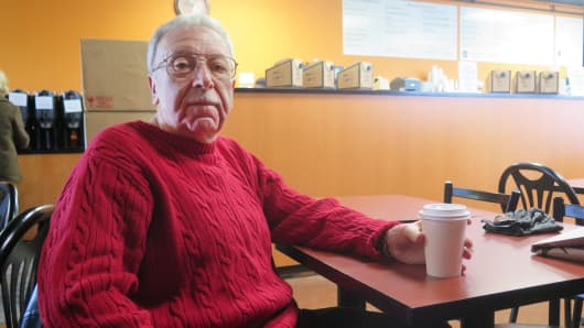 John Cordora, 63, sits in the Bakehouse coffee shop in Kingston, PA. Cordora, who says he supported Trump from the day he launched his campaign, has no problem with Trump's wealthy Cabinet picks because of their business success.