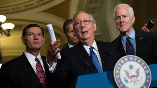 Sen. John Barrasso (R-WY), Sen. John Thune (R-SD), Senate Majority Leader Mitch McConnell (R-KY) and Sen. John Cornyn (R-TX) take questions from reporters during news conference after their weekly policy meeting with Senate Republicans.