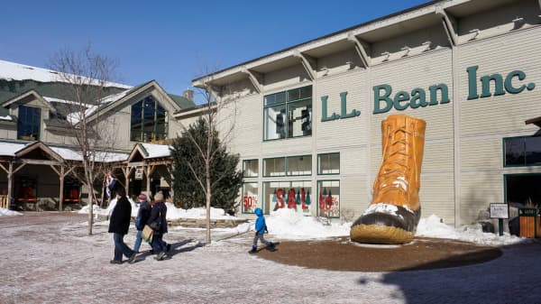 People walk through a plaza at an entrance to the L.L. Bean flagship store in Freeport, Maine on Monday, January 9, 2017.