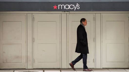 A man walks past a Macy's department store in Washington, DC.