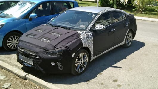 Ford Mondeo disguised in a camouflage wrap in order to hide its new styling and detail, outside a building on August 27, 2015 in Granada, Spain.