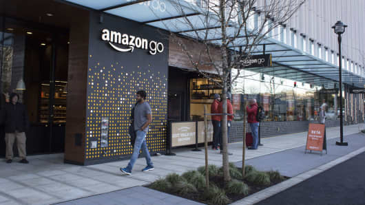 A pedestrian passes in front of the new Amazon Go grocery store in Seattle.