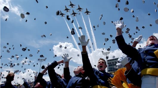 Cadets toss their hats in celebration after becoming newly commissioned first lieutenants marking the 45th graduating class at the U.S. Air Force Academy in Colorado Springs, Colorado.