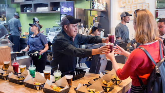 A worker serves sangria at a Taco Bell Cantina restaurant in Chicago, Illinois.