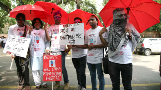 New Delhi, 2014: Activists of AIDS Healthcare foundation (AHF) protest against trade deals that minimize the supply of affordable generic HIV pills.