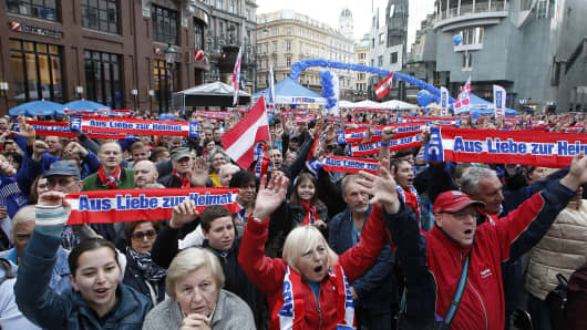 Supporters listen to Austrian Freedom party (FPOe) head and main candidate Heinz-Christian Strache speaking during a rally on September 27, 2013 ahead of next parliament election. Austrians are expected to opt for stability in elections on September 29, 2013 and return the current centrist coalition to power.