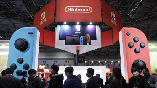 Attendees wait in line to play video games on Nintendo Switch game consoles during the new console's unveiling in Tokyo on Jan. 13, 2017.