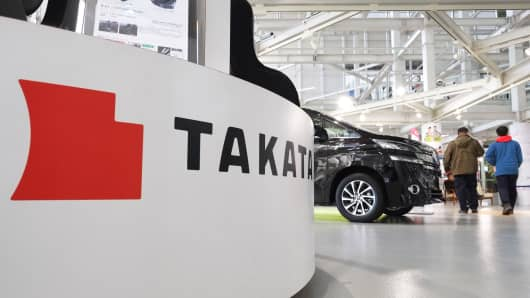 The logo of the Japanese auto parts maker Takata is displayed at a car showroom in Tokyo on January 13, 2017.