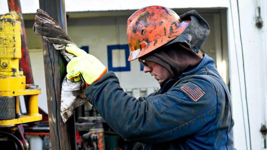 A worker on a an oil drill near New Town, North Dakota.