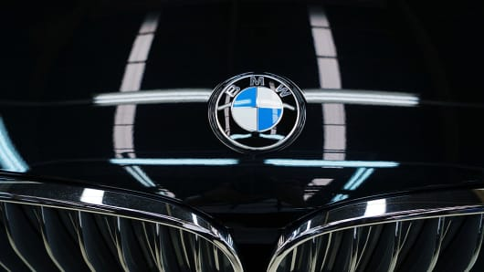 A BMW AG badge is displayed on the company's 7-Series sedan at the assembly line on Nov. 30, 2016.