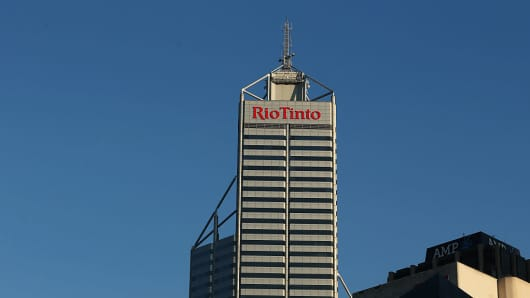 Signage for Rio Tinto is displayed atop the company's offices in the central business district of Perth, Australia, on Friday, Oct. 28, 2016.