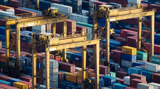 Stacked containers sit among gantry cranes at Tanjong Pagar Container Terminal at the Port of Singapore in Singapore.
