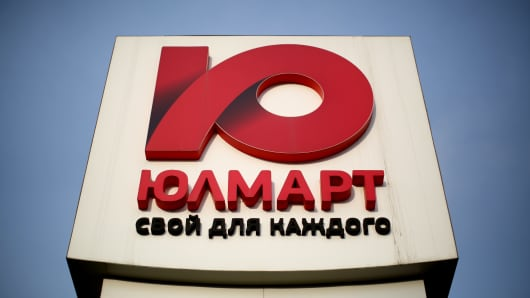A logo for Ulmart stands on display above a fulfilment center in Saint Petersburg, Russia