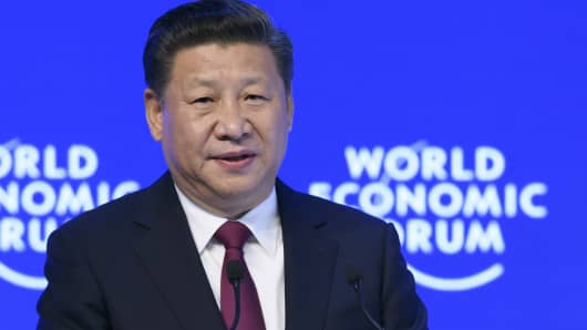 China's President Xi Jinping delivers a speech on the opening day of the World Economic Forum, on January 17, 2017 in Davos.