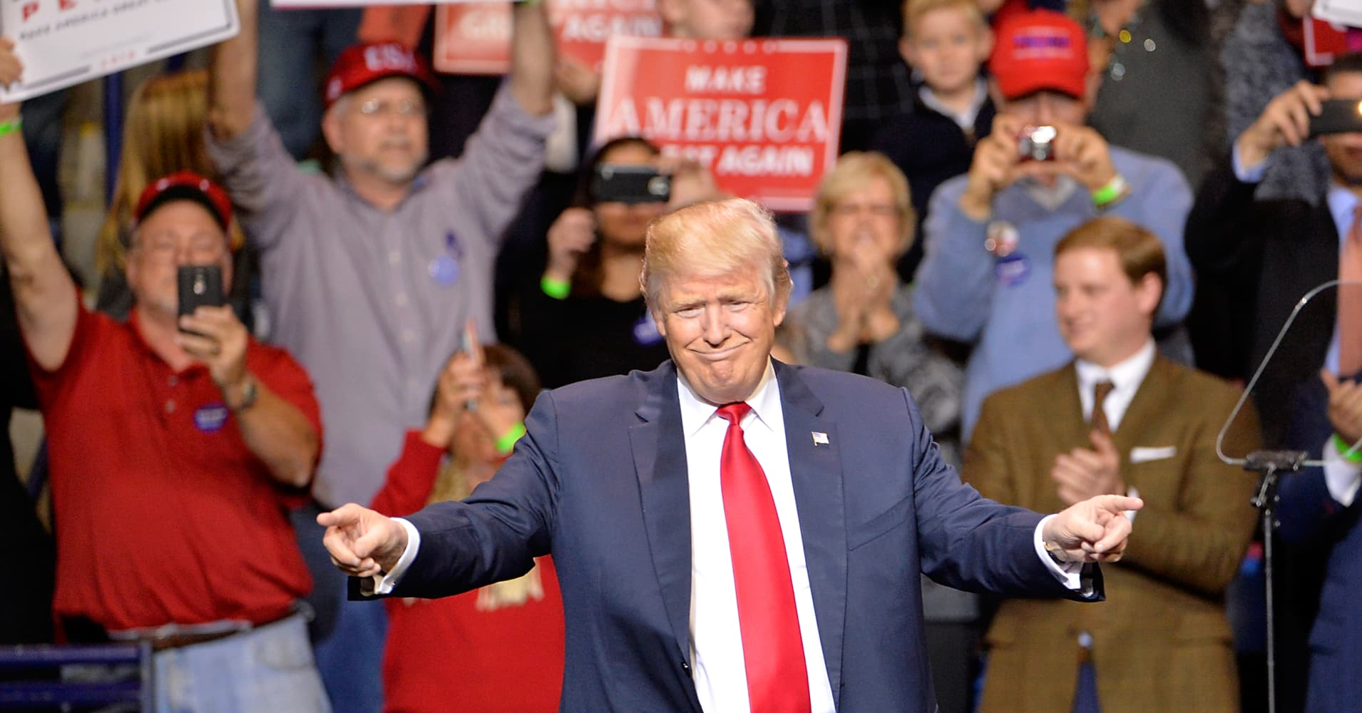 Donald Trump points to his supporters during his 'Thank You' rally at Crown Coliseum on December 6, 2016 in Fayetteville, North Carolina.
