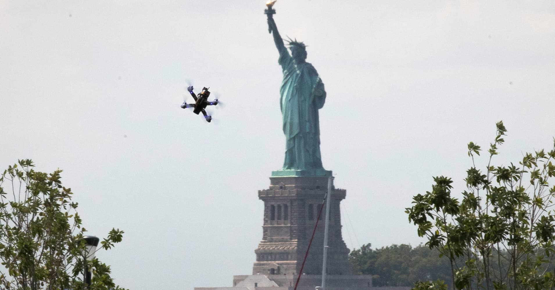A drone flies near the Statue of Liberty in New York.